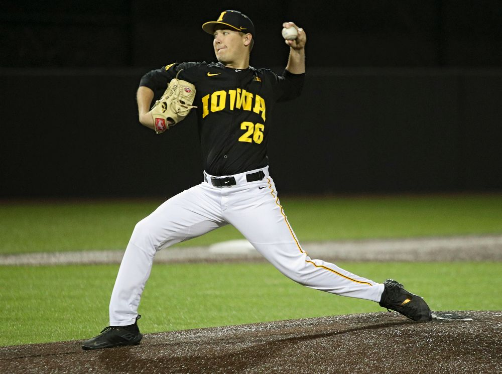 Iowa pitcher Adam Ketelsen (26) delivers to the plate during the eighth inning of their game at Duane Banks Field in Iowa City on Tuesday, March 3, 2020. (Stephen Mally/hawkeyesports.com)