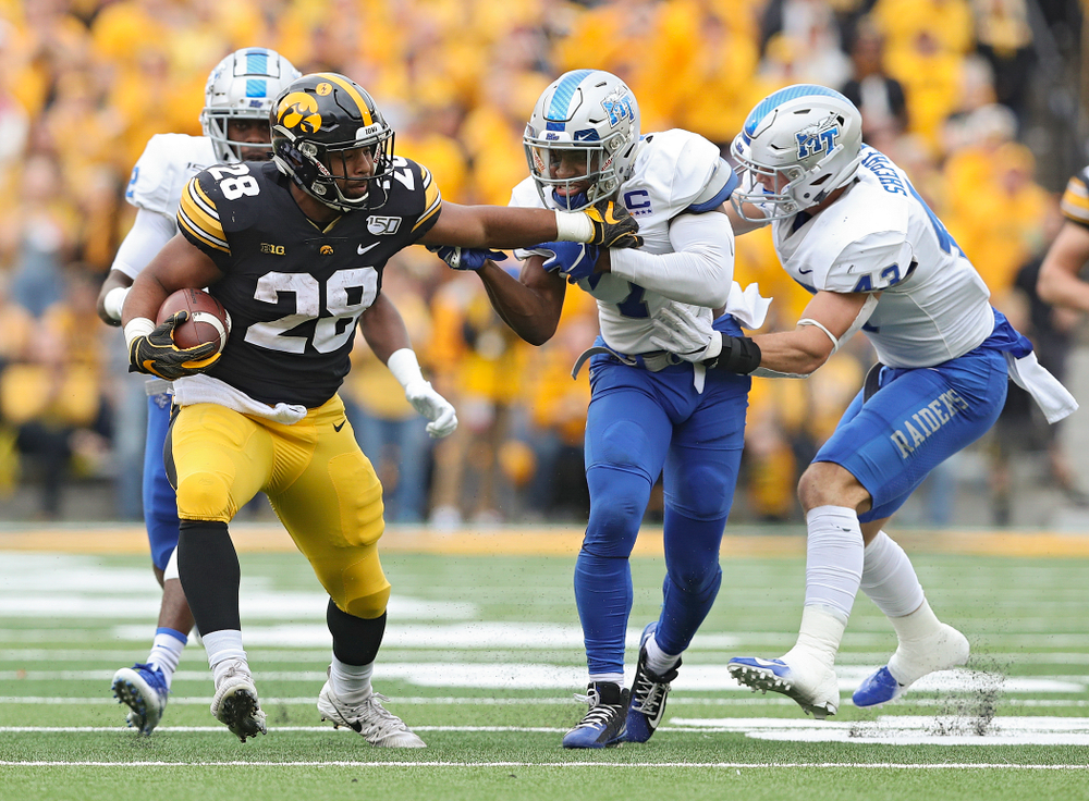Iowa Hawkeyes running back Toren Young (28) drags defenders on a run during third quarter of their game at Kinnick Stadium in Iowa City on Saturday, Sep 28, 2019. (Stephen Mally/hawkeyesports.com)