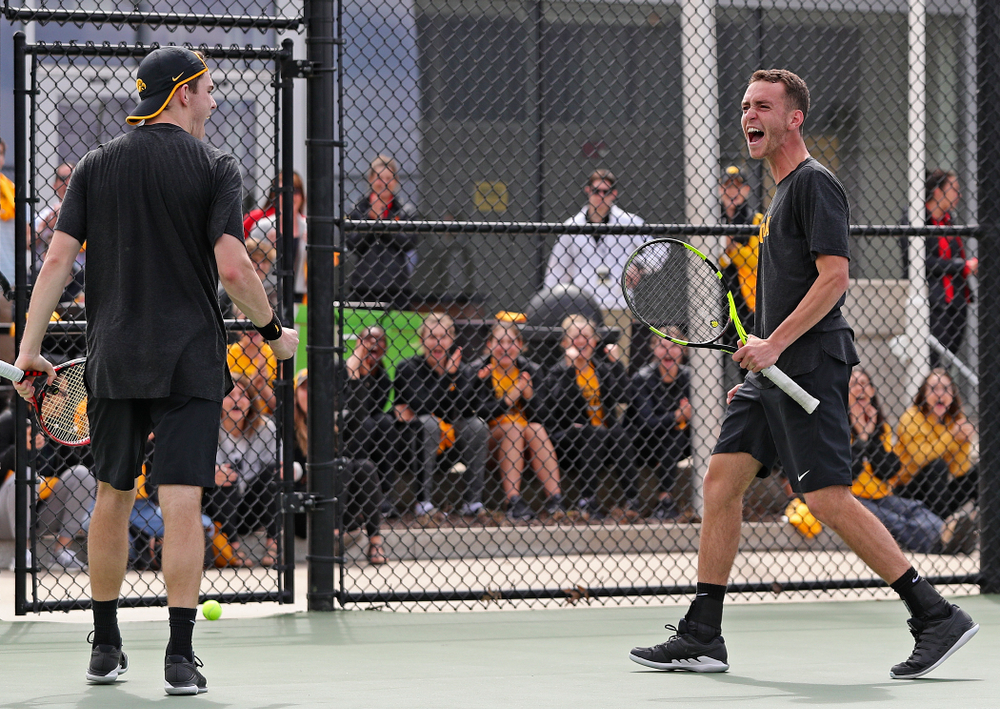 Iowa's Kareem Allaf (right) and Jonas Larsen celebrate a score during a double match against Ohio State at the Hawkeye Tennis and Recreation Complex in Iowa City on Sunday, Apr. 7, 2019. (Stephen Mally/hawkeyesports.com)