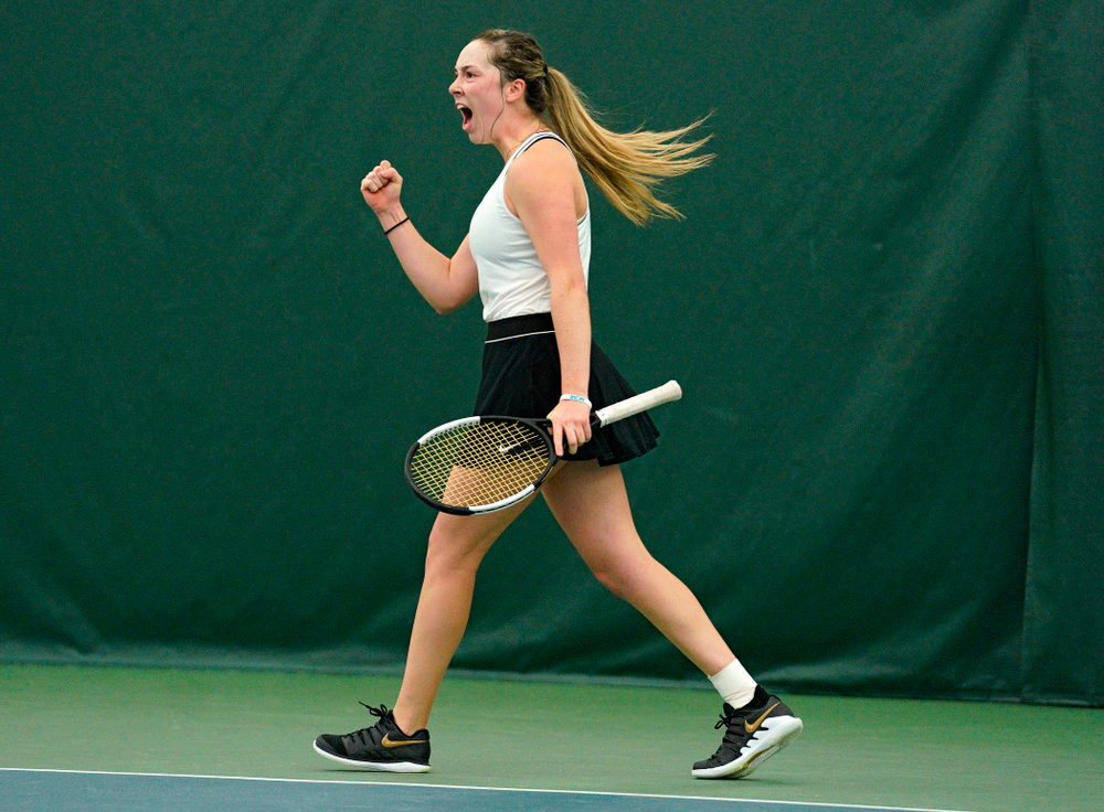 Iowa's Samantha Mannix celebrates a point during her doubles match at the Hawkeye Tennis and Recreation Complex in Iowa City on Sunday, February 16, 2020. (Stephen Mally/hawkeyesports.com)