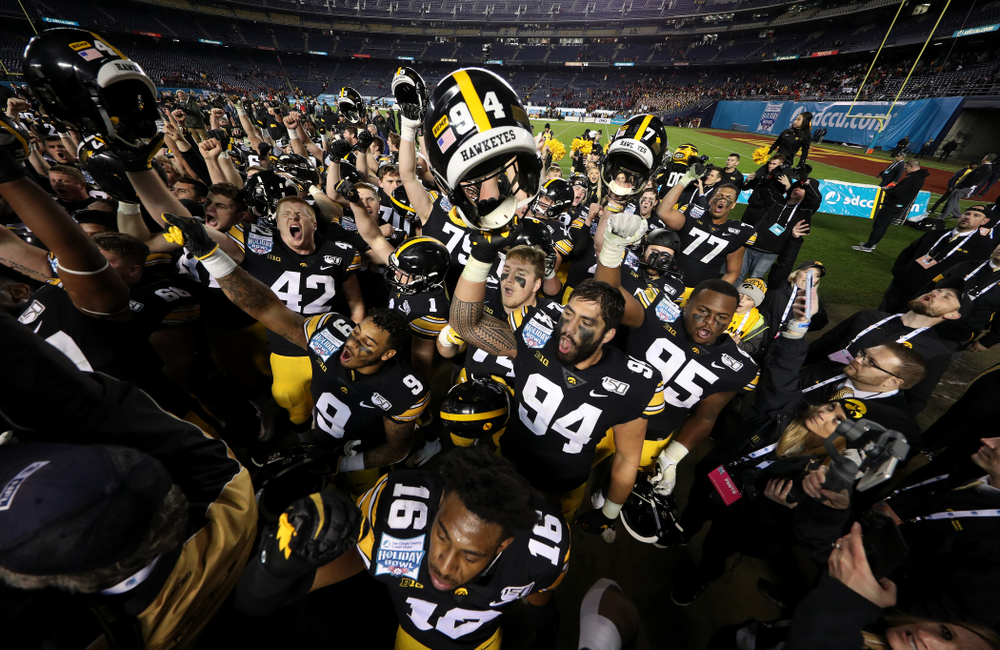 The Iowa Hawkeyes sing the Fight Song after their win against USC in the Holiday Bowl Friday, December 27, 2019 at San Diego Community Credit Union Stadium.  (Brian Ray/hawkeyesports.com)