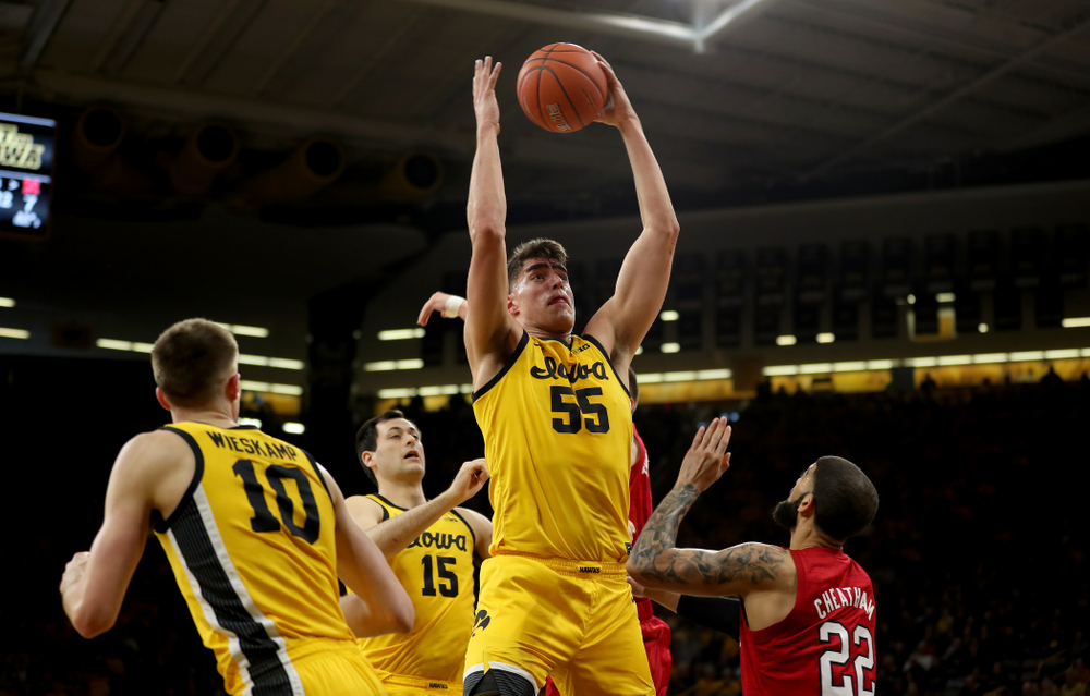 Iowa Hawkeyes forward Luka Garza (55) grabs a rebound against the Nebraska Cornhuskers Saturday, February 8, 2020 at Carver-Hawkeye Arena. (Brian Ray/hawkeyesports.com)