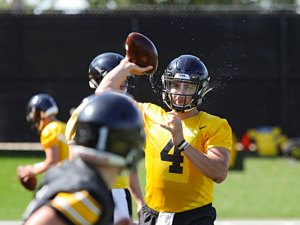 Iowa Hawkeyes quarterback Nate Stanley (4) throws a wet football as they run a drill during Fall Camp Practice No. 13 at the Hansen Football Performance Center in Iowa City on Friday, Aug 16, 2019. (Stephen Mally/hawkeyesports.com)