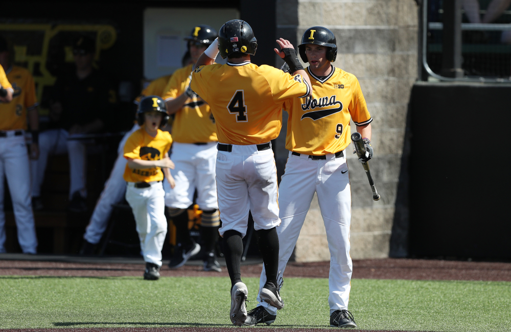 Iowa Hawkeyes infielder Mitchell Boe (4) and outfielder Ben Norman (9) against the Nebraska Cornhuskers Sunday, April 21, 2019 at Duane Banks Field. (Brian Ray/hawkeyesports.com)