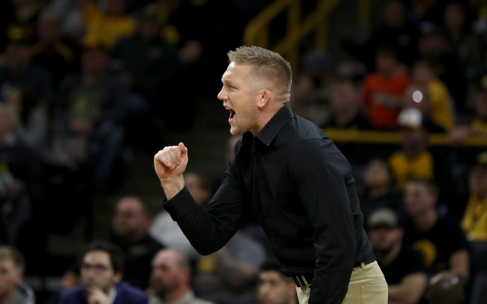 Iowa assistant coach Ryan Morningstar cheers as Max Murin wrestles WisconsinÕs Tristan Moran at 141 pounds Sunday, December 1, 2019 at Carver-Hawkeye Arena. Murin won the match 3-2. (Brian Ray/hawkeyesports.com)