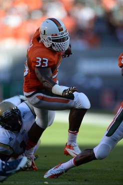 University of Miami Hurricanes running back Maurice Hagens #33 and the Canes take on the Georgia Tech Yellow Jackets at Sun Life Stadium on October 5,...