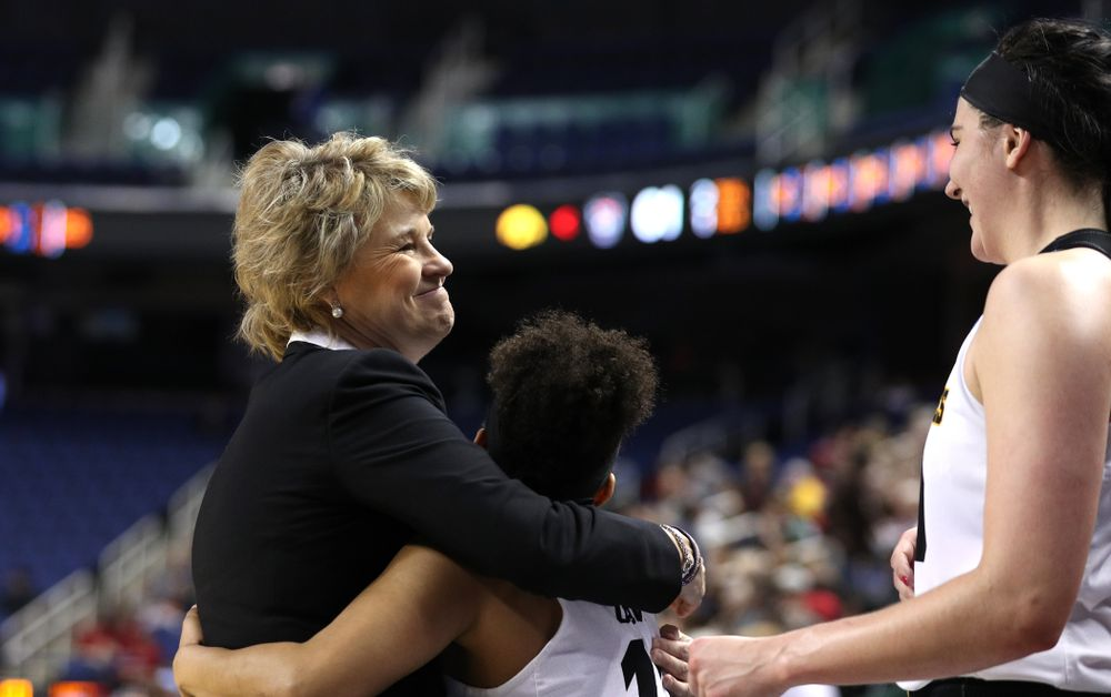 Iowa Hawkeyes head coach Lisa Bluder and guard Tania Davis (11) against the NC State Wolfpack in the regional semi-final of the 2019 NCAA Women's College Basketball Tournament Saturday, March 30, 2019 at Greensboro Coliseum in Greensboro, NC.(Brian Ray/hawkeyesports.com)