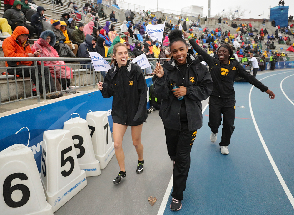 Iowa's Talia Buss, Briana Guillory, Taylor Arco (behind), and Antonise Christian take a victory lap after winning the women's sprint medley relay event during the third day of the Drake Relays at Drake Stadium in Des Moines on Saturday, Apr. 27, 2019. (Stephen Mally/hawkeyesports.com)