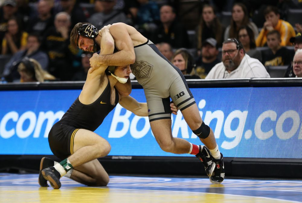 Iowa's Austin DeSanto wrestles Purdue's Ben Thornton at 133 pounds Saturday, November 24, 2018 at Carver-Hawkeye Arena. (Brian Ray/hawkeyesports.com)
