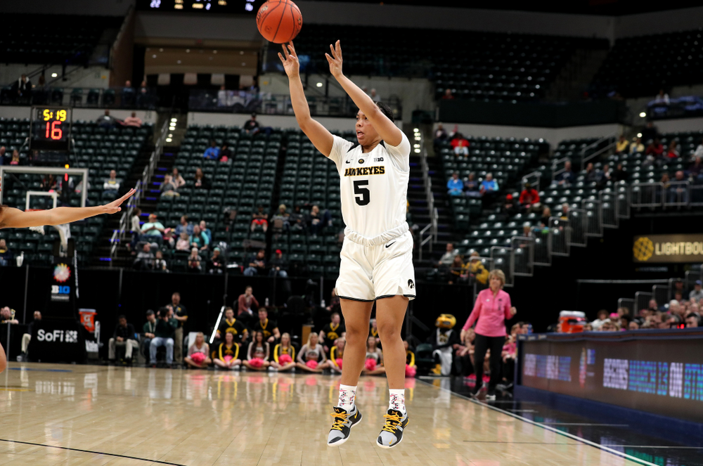 Iowa Hawkeyes guard Alexis Sevillian (5) against the Rutgers Scarlet Knights in the semi-finals of the Big Ten Tournament Saturday, March 9, 2019 at Bankers Life Fieldhouse in Indianapolis, Ind. (Brian Ray/hawkeyesports.com)