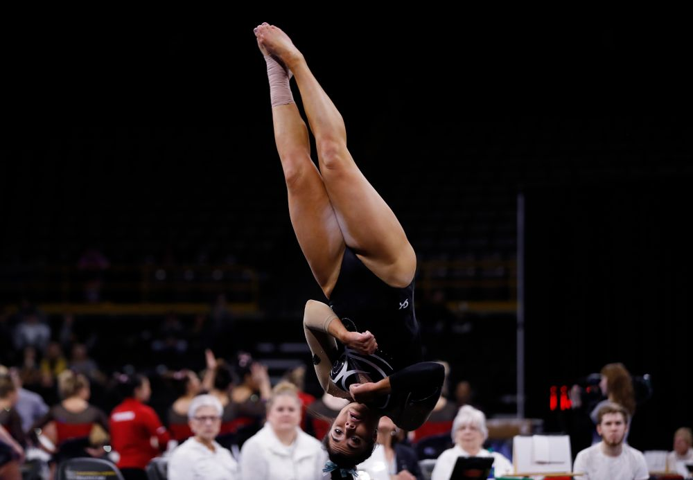 Iowa's Nikki Youd competes on the floor against the Nebraska Cornhuskers