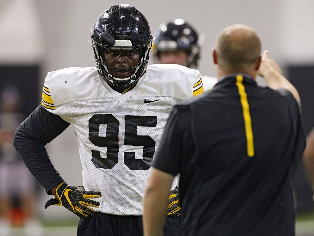 Iowa Hawkeyes defensive lineman Cedrick Lattimore (95) listens to Iowa Hawkeyes linebackers coach Seth Wallace during Fall Camp Practice No. 9 at the Hansen Football Performance Center in Iowa City on Monday, Aug 12, 2019. (Stephen Mally/hawkeyesports.com)