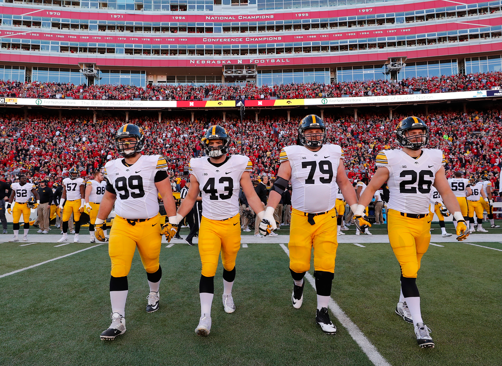 Iowa Hawkeyes captains Nathan Bazata, Josey Jewell, Sean Welsh, and Kevin Ward
