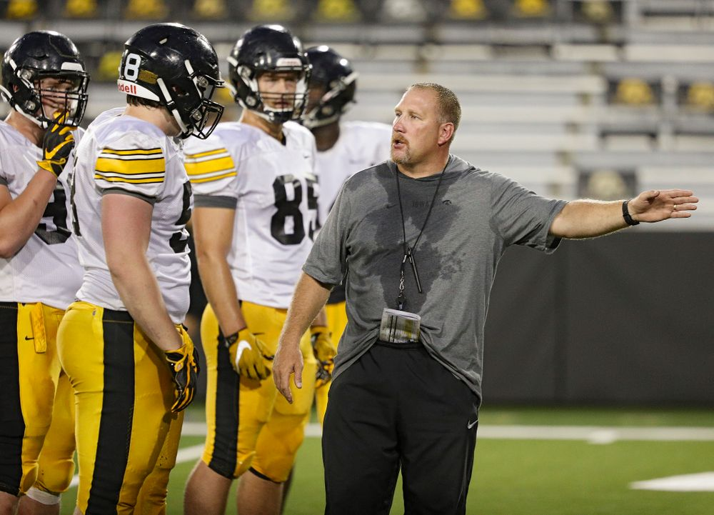 Iowa Hawkeyes offensive line coach Tim Polasek talks with offensive lineman Taylor Fox (58) during Fall Camp Practice No. 12 at Kinnick Stadium in Iowa City on Thursday, Aug 15, 2019. (Stephen Mally/hawkeyesports.com)