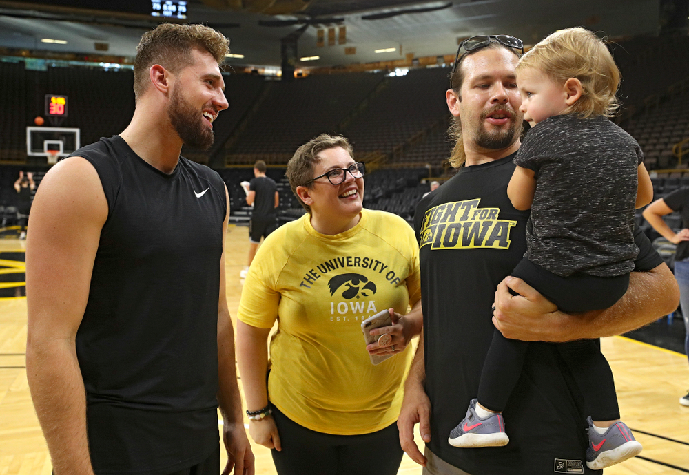 Iowa Hawkeyes guard Jordan Bohannon (3) talks with visitors from University of Iowa Hospitals and Clinics Adolescent and Young Adult (AYA) Cancer Program after practice at Carver-Hawkeye Arena in Iowa City on Monday, Sep 30, 2019. (Stephen Mally/hawkeyesports.com)