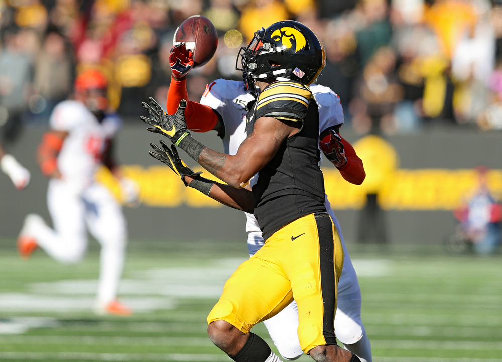 Iowa Hawkeyes wide receiver Ihmir Smith-Marsette (6) pulls in a pass during the third quarter of their game at Kinnick Stadium in Iowa City on Saturday, Nov 23, 2019. (Stephen Mally/hawkeyesports.com)