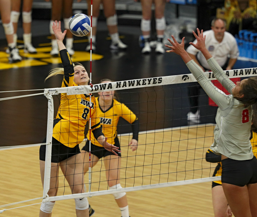 Iowa's Kyndra Hansen (8) lines up a shot during the second set of their match at Carver-Hawkeye Arena in Iowa City on Friday, Nov 29, 2019. (Stephen Mally/hawkeyesports.com)