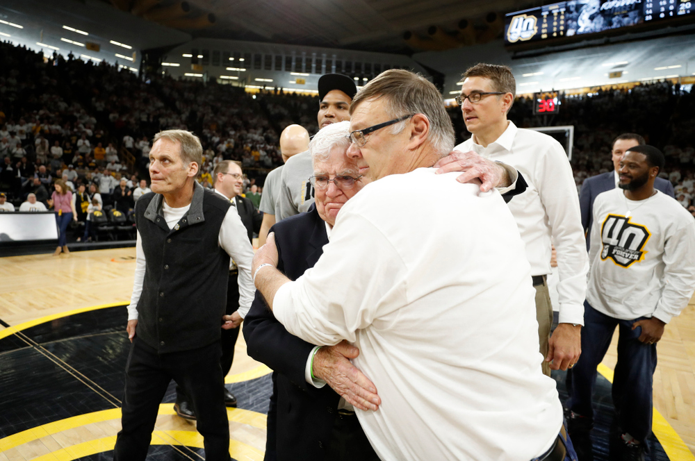 Mike Street hugs former head coach Tom Davis