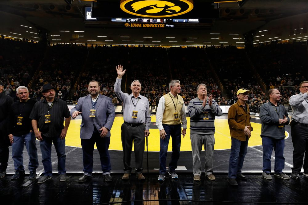 Former Big Ten champions are recognized during the Hawkeyes meet against Minnesota