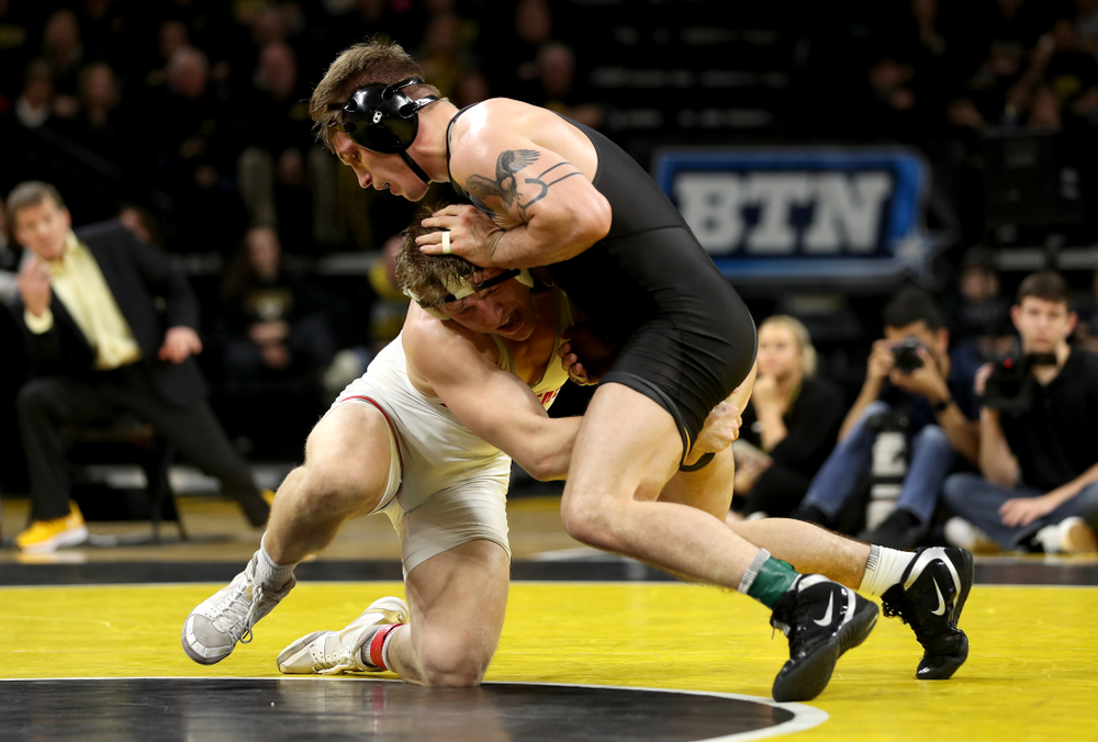 Iowa's Cash Wilcke wrestles Ohio State's Kollin Moore at 197 pounds Friday, January 24, 2020 at Carver-Hawkeye Arena. Moore won the match 8-3. (Brian Ray/hawkeyesports.com)