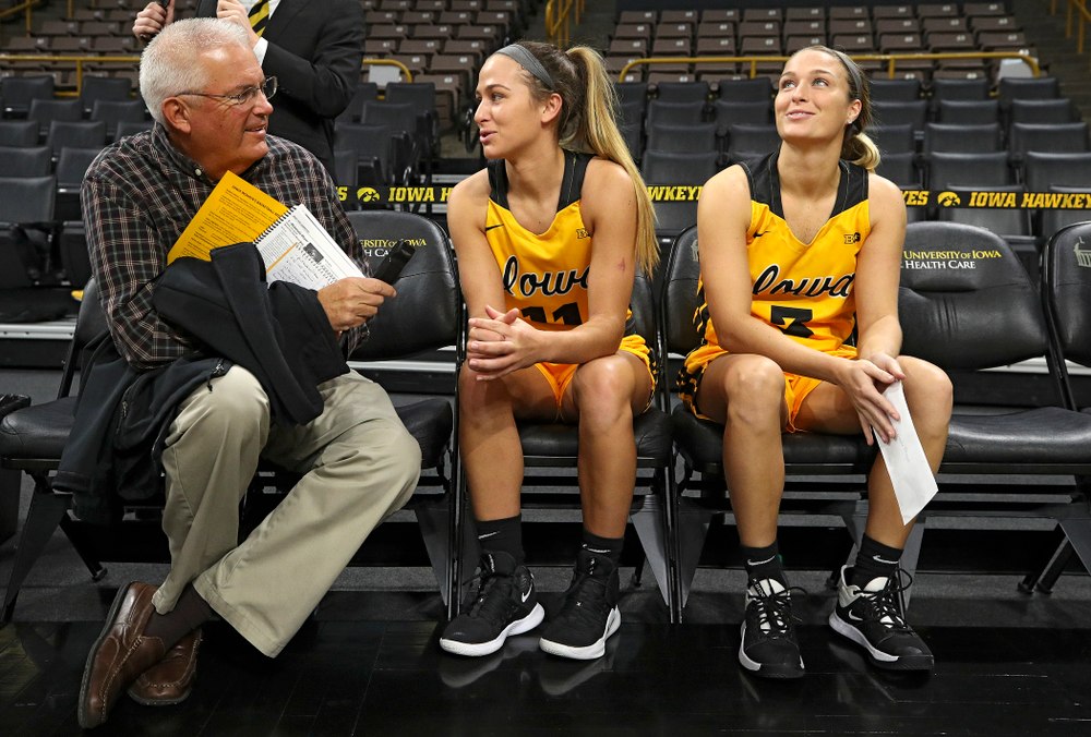 Iowa guard Megan Meyer (11) answers questions as her sister guard Makenzie Meyer (3) looks on during Iowa Women's Basketball Media Day at Carver-Hawkeye Arena in Iowa City on Thursday, Oct 24, 2019. (Stephen Mally/hawkeyesports.com)