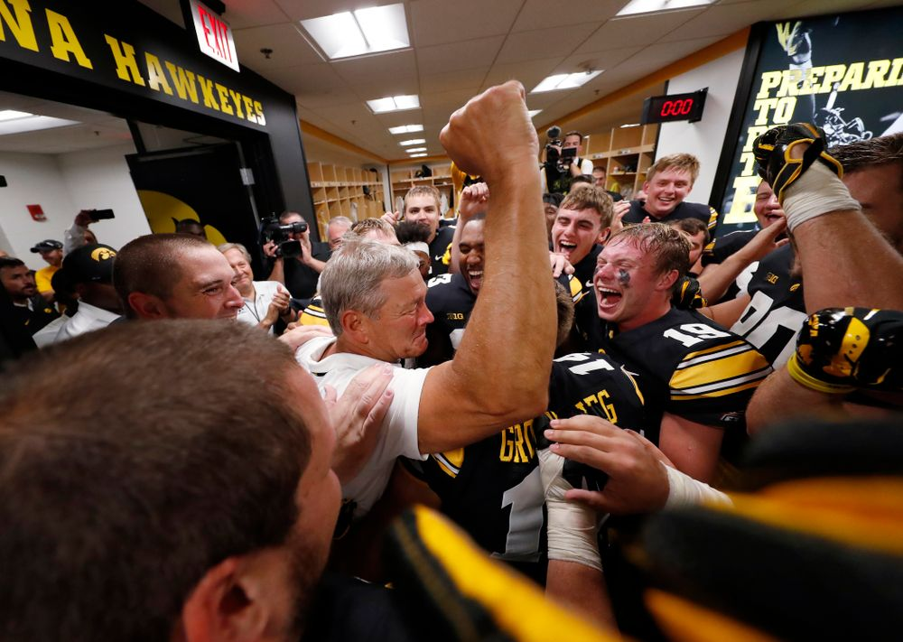 Iowa Hawkeyes head coach Kirk Ferentz  celebrates his historic victory with his team following their game against the Northern Illinois Huskies Saturday, September 1, 2018 at Kinnick Stadium. (Brian Ray/hawkeyesports.com)