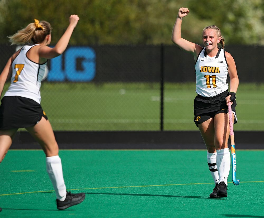 Iowa's Ellie Holley (7) and Katie Birch (11) celebrate after Birch scored a goal during the second quarter of their game at Grant Field in Iowa City on Friday, Sep 13, 2019. (Stephen Mally/hawkeyesports.com)