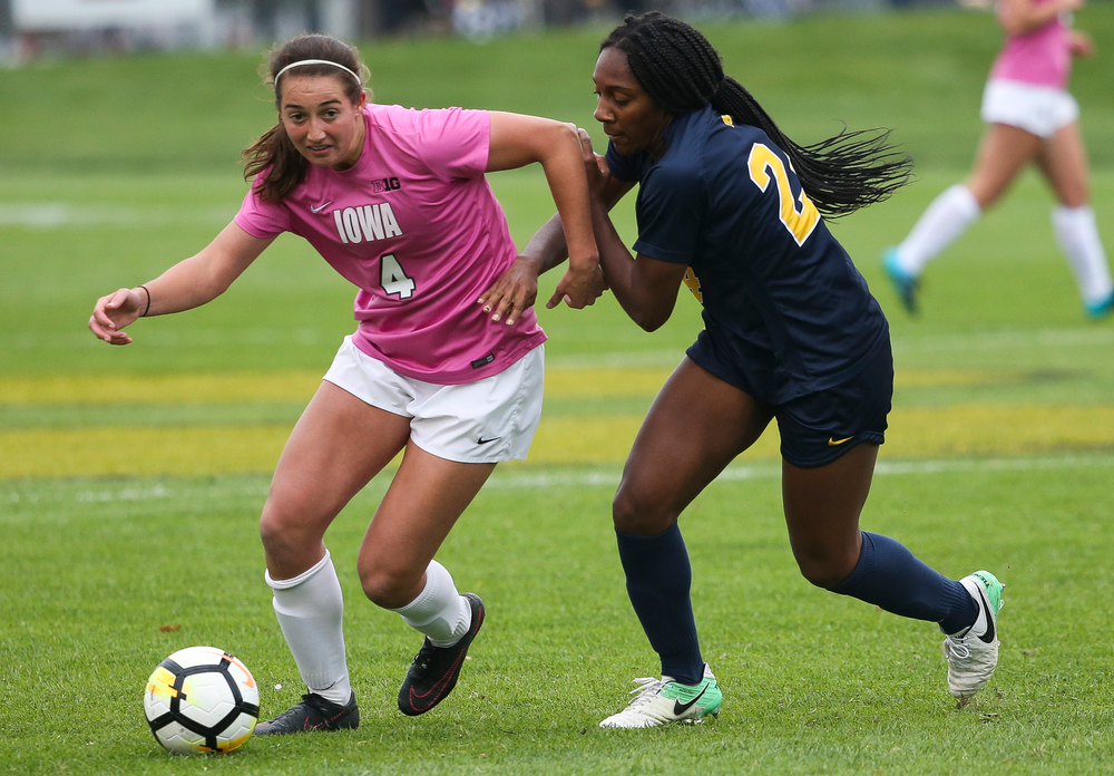 Iowa Hawkeyes forward Kaleigh Haus (4) dribbles the ball during a game against Michigan at the Iowa Soccer Complex on October 14, 2018. (Tork Mason/hawkeyesports.com)