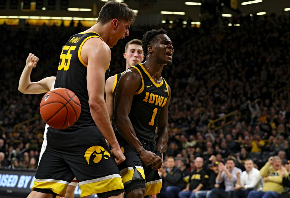 Iowa Hawkeyes guard Joe Toussaint (1) and center Luka Garza (55) celebrate after Toussaint scored a basket while being fouled during the first half of their game at Carver-Hawkeye Arena in Iowa City on Monday, January 27, 2020. (Stephen Mally/hawkeyesports.com)