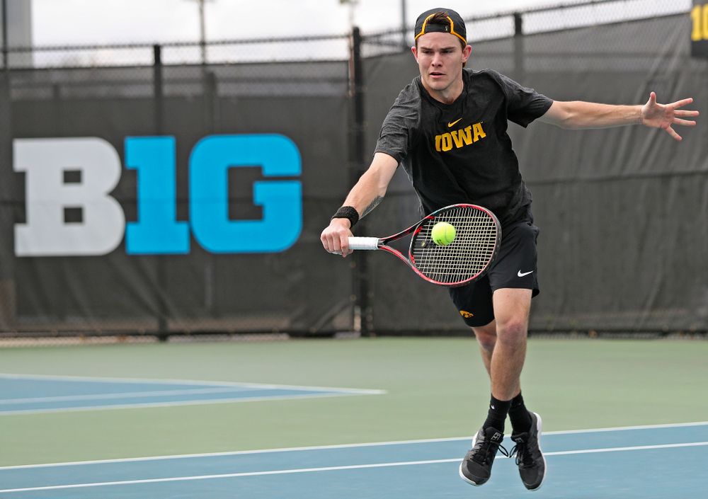 Iowa's Jonas Larsen competes during a double match against Ohio State at the Hawkeye Tennis and Recreation Complex in Iowa City on Sunday, Apr. 7, 2019. (Stephen Mally/hawkeyesports.com)