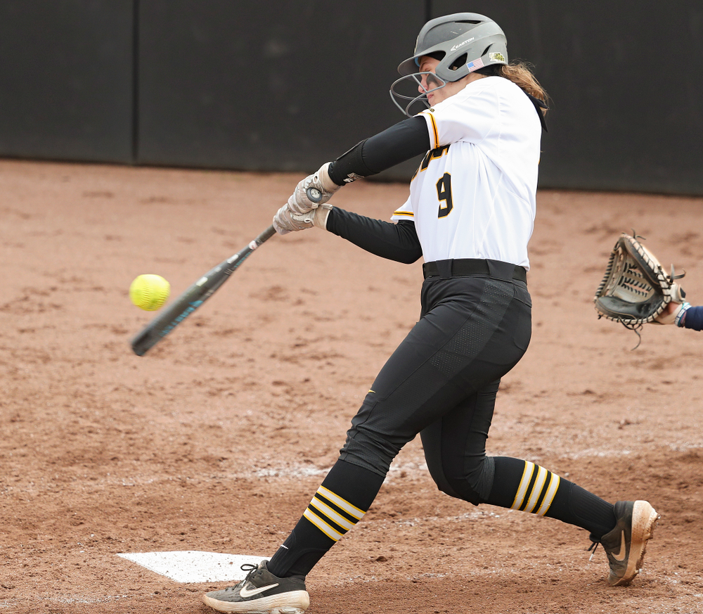 Iowa catcher Abby Lien (9) bats during the fourth inning of their game against Illinois at Pearl Field in Iowa City on Friday, Apr. 12, 2019. (Stephen Mally/hawkeyesports.com)