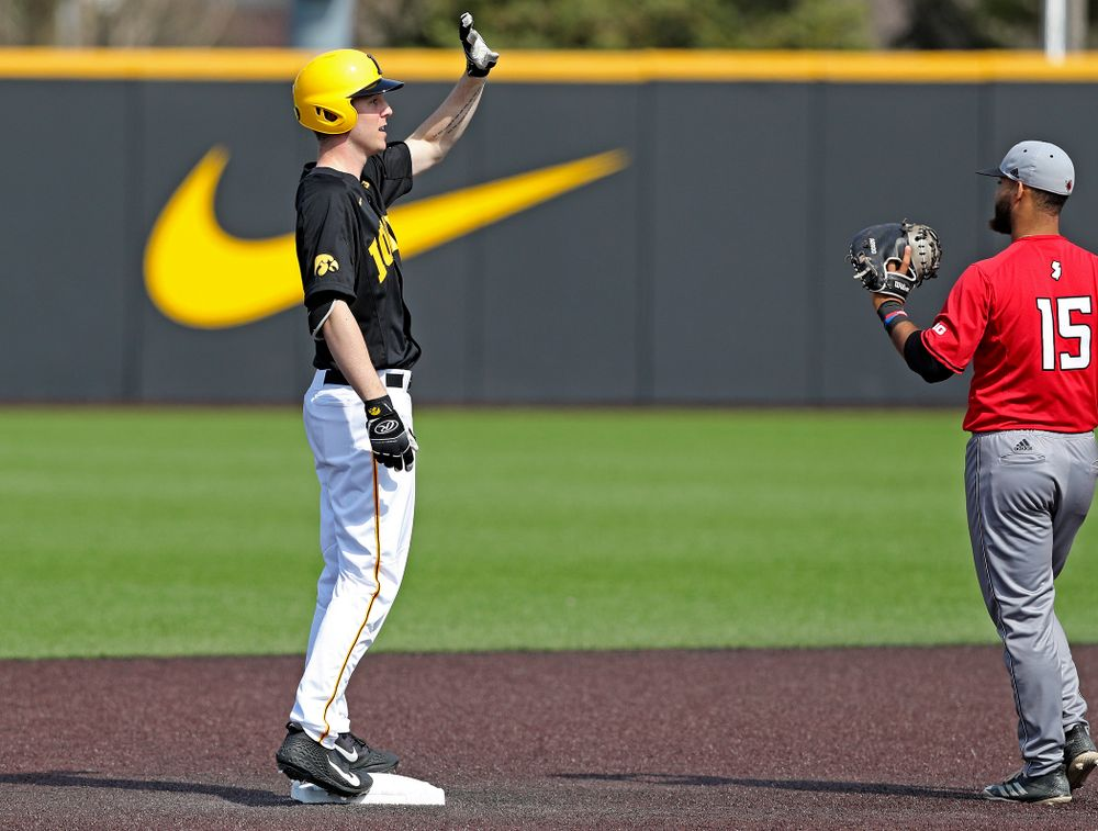 Iowa Hawkeyes right fielder Connor McCaffery (30) waves as he stands on second base after hitting a double during the fourth inning of their game against Rutgers at Duane Banks Field in Iowa City on Saturday, Apr. 6, 2019. (Stephen Mally/hawkeyesports.com)