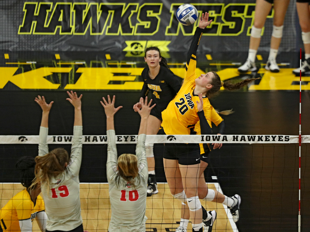 Iowa's Edina Schmidt (20) lines up a shot during the second set of their match at Carver-Hawkeye Arena in Iowa City on Friday, Nov 29, 2019. (Stephen Mally/hawkeyesports.com)