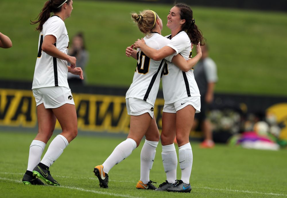 Iowa Hawkeyes midfielder/defender Natalie Winters (10) hugs forward Devin Burns (30) after scoring on a penalty kick during a 6-1 win over Northern Iowa Sunday, August 25, 2019 at the Iowa Soccer Complex. (Brian Ray/hawkeyesports.com)