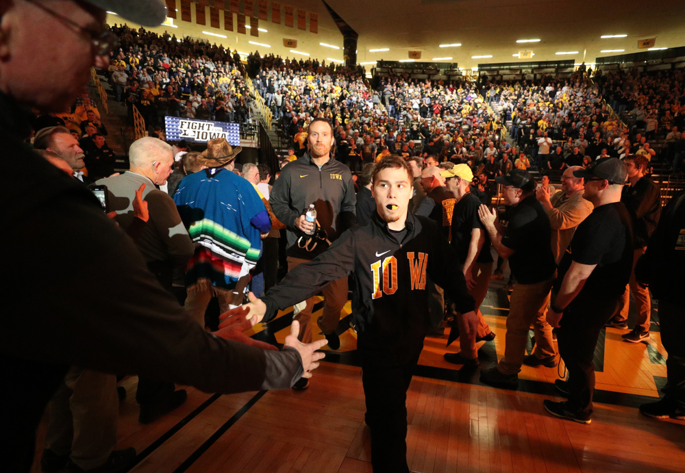 Spencer Lee slaps hands in the alumni tunnel before the Iowa Hawkeyes meet against Oklahoma State's at pounds Sunday, February 23, 2020 at Carver-Hawkeye Arena. (Brian Ray/hawkeyesports.com)