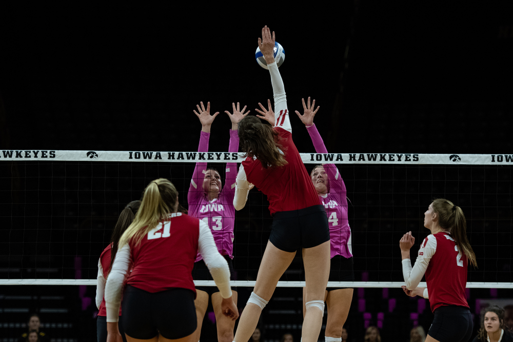 Iowa Hawkeyes middle blocker Sarah Wing (13) and outside hitter Cali Hoye (14) against the Wisconsin Badgers Saturday, October 6, 2018 at Carver-Hawkeye Arena. (Clem Messerli/Iowa Sports Pictures)
