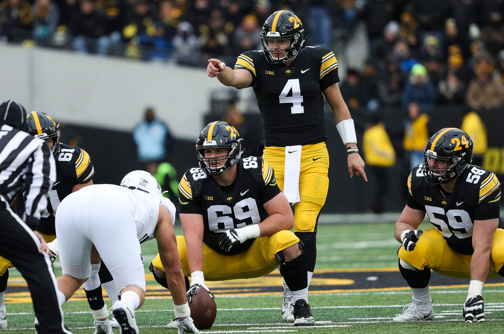 Iowa Hawkeyes quarterback Nate Stanley (4) calls out signals before the snap during a game against Northwestern at Kinnick Stadium on November 10, 2018. (Tork Mason/hawkeyesports.com)