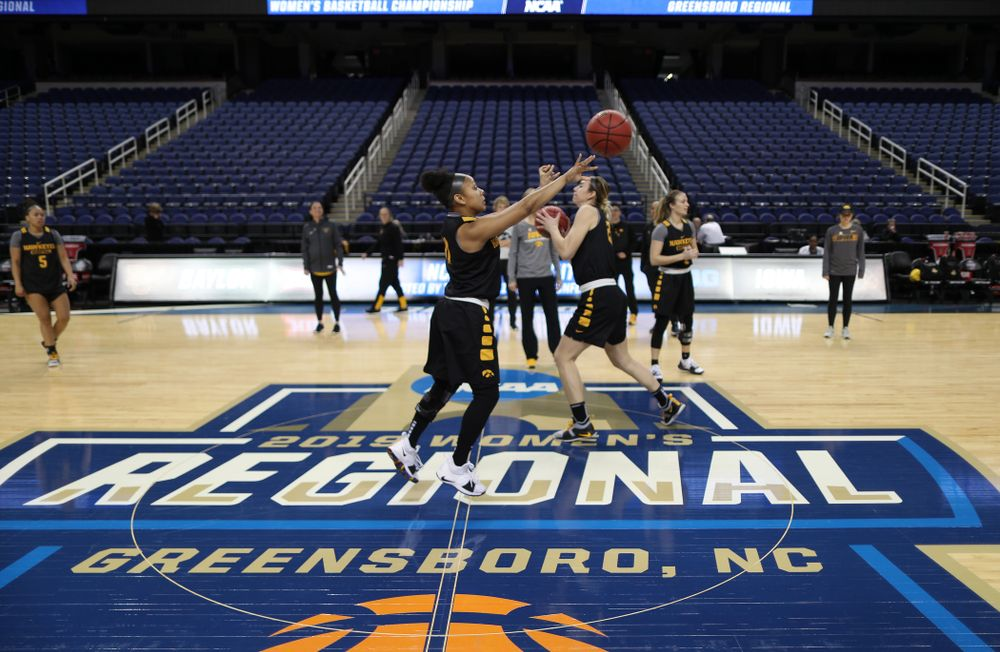 Iowa Hawkeyes guard Tania Davis (11) sinks a half court shot during shoot around before their regional final against the Baylor Lady Bears in the 2019 NCAA Women's College Basketball Tournament Monday, April 1, 2019 at Greensboro Coliseum in Greensboro, NC.(Brian Ray/hawkeyesports.com)