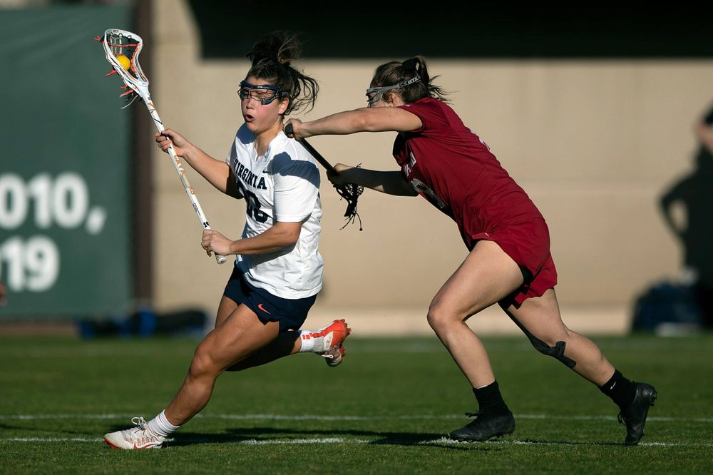 STANFORD, California - FEBRUARY 14:  Virginia Cavaliers midfield Kiki Shaw (23) is defended by Stanford Cardinal defense Kyra Pelton (8) during the first half at Cagan Stadium on February 14, 2020 in Stanford, California. The Virginia Cavaliers defeated the Stanford Cardinal 12-11. (Photo by Jason O. Watson)
