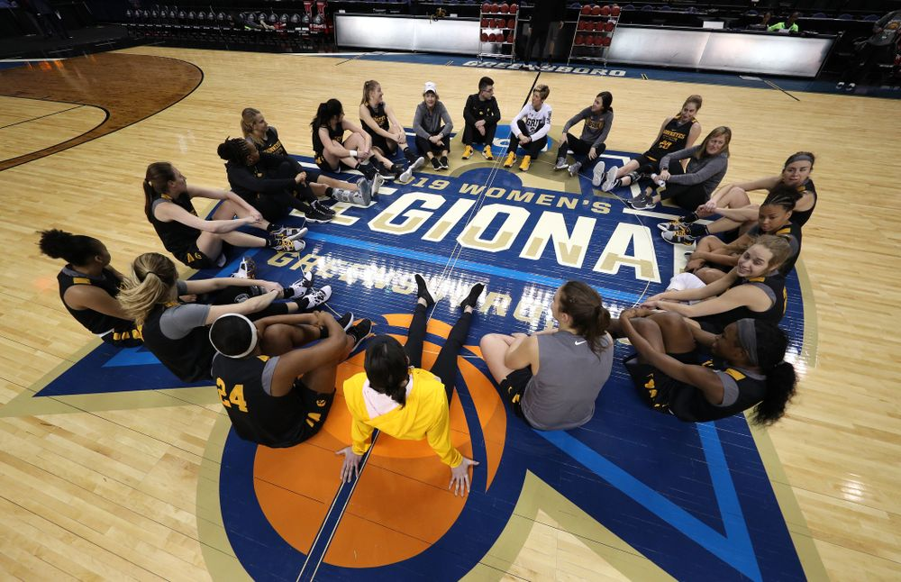 The Iowa Hawkeyes talk in their circle at the end of shoot around before their game against the NC State Wolfpack in the regional semi-final of the 2019 NCAA Women's College Basketball Tournament Saturday, March 30, 2019 at Greensboro Coliseum in Greensboro, NC.(Brian Ray/hawkeyesports.com)