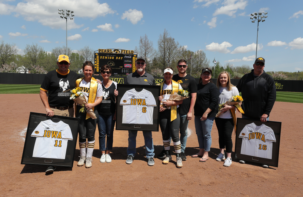Iowa Hawkeyes seniors Mallory Kilian (11), Erin Riding (6) and Brooke Rozier pose for a photo during senior day festivities following their game against the Ohio State Buckeyes on senior day Sunday, May 5, 2019 at Pearl Field. (Brian Ray/hawkeyesports.com)