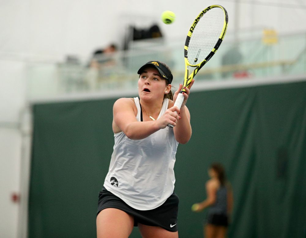 Iowa's Danielle Bauers returns a shot during her singles match at the Hawkeye Tennis and Recreation Complex in Iowa City on Sunday, February 23, 2020. (Stephen Mally/hawkeyesports.com)