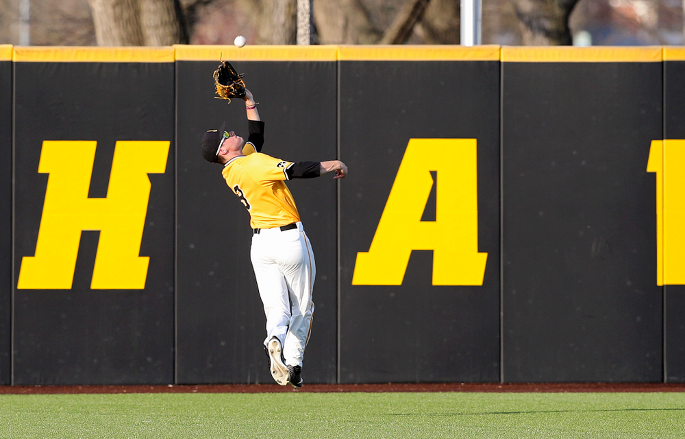 Iowa Hawkeyes center fielder Ben Norman (9) makes a catch on the run for an out during the seventh inning of their game against Northern Illinois at Duane Banks Field in Iowa City on Tuesday, Apr. 16, 2019. (Stephen Mally/hawkeyesports.com)