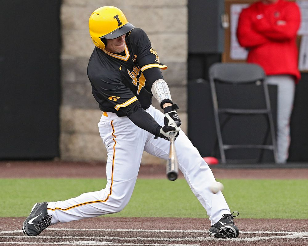 Iowa Hawkeyes catcher Austin Martin (34) drives a pitch for a hit during the third inning of their game against Illinois State at Duane Banks Field in Iowa City on Wednesday, Apr. 3, 2019. (Stephen Mally/hawkeyesports.com)