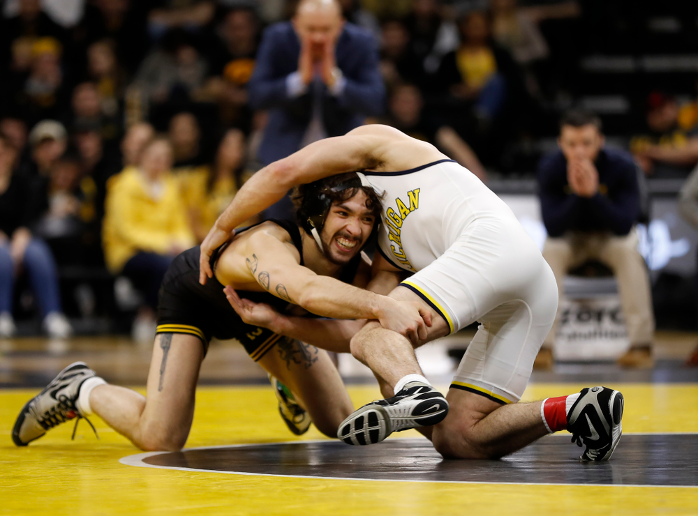 Iowa's Vince Turk against Michigan's Sal Profaci at 141 pounds
