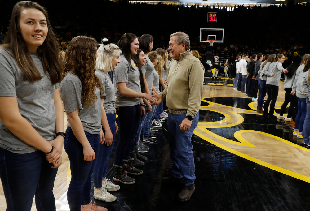 University of Iowa President Bruce Harreld shakes hands with the rowing team during the PCA recognition