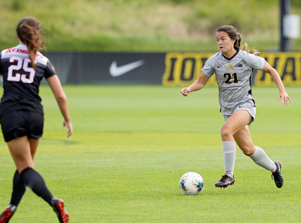 Iowa forward Emma Tokuyama (21) moves with the ball during the first half of their match at the Iowa Soccer Complex in Iowa City on Sunday, Sep 1, 2019. (Stephen Mally/hawkeyesports.com)