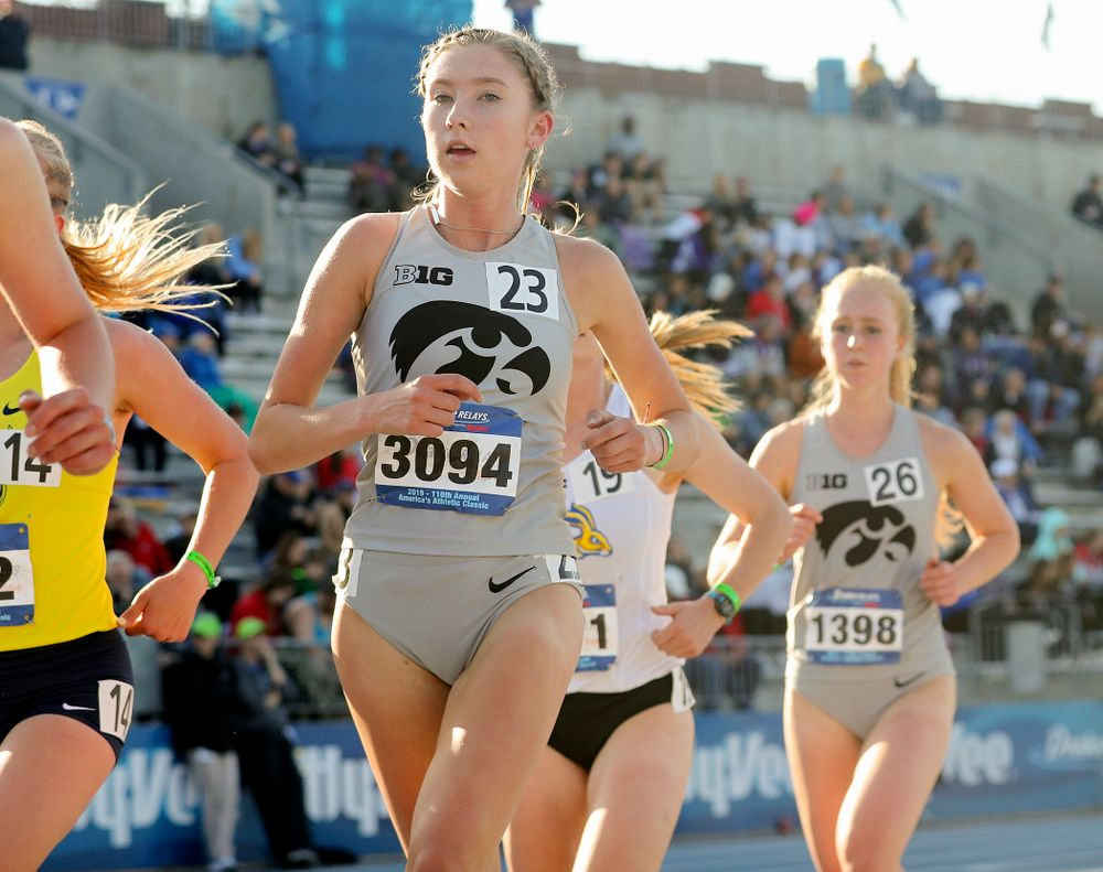 Iowa's Jessica McKee (left) and Kylie Latham (right) run the women's 10,000 meter event during the first day of the Drake Relays at Drake Stadium in Des Moines on Thursday, Apr. 25, 2019. (Stephen Mally/hawkeyesports.com)