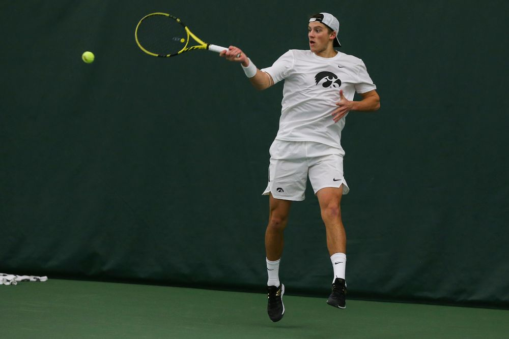 Iowa's Joe Tyler hits a forehand during the Iowa men's tennis match vs Western Michigan on Saturday, January 18, 2020 at the Hawkeye Tennis and Recreation Complex. (Lily Smith/hawkeyesports.com)