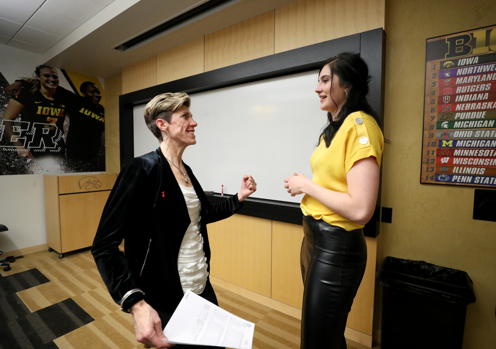 Megan Gustafson talks with associate head coach Jan Jensen following a jersey retirement ceremony Sunday, January 26, 2020 at Carver-Hawkeye Arena. (Brian Ray/hawkeyesports.com)